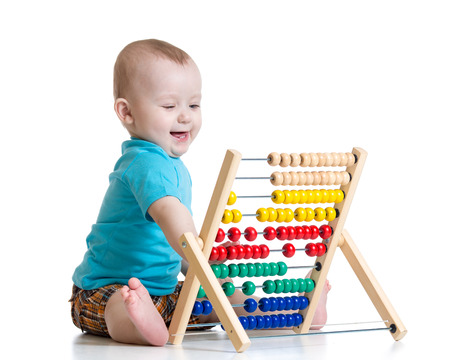 early education: Baby with abacus toy. Concept of early learning child Stock Photo
