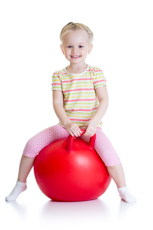 child ball: happy little girl jumping on bouncing ball. Isolated on white.