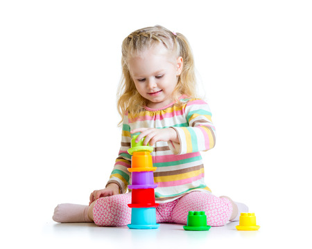 child little girl playing with color toys photo