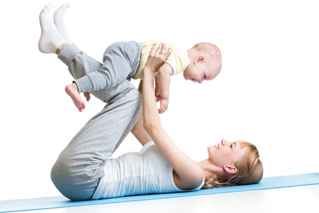 fit women: happy mother and baby making healthy gymnastics Stock Photo