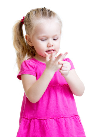 child girl counting on fingers of her hands isolated photo