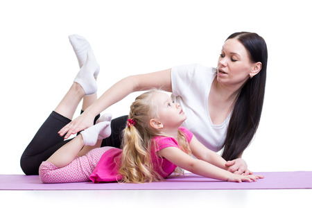 teaches: mother teaches kid girl exercising showing by example, isolated Stock Photo