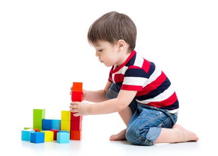 kids activities: kid child boy playing on floor isolated Stock Photo