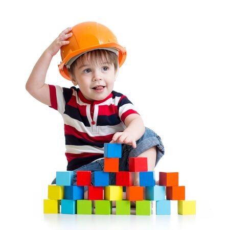 little child boy with hard hat and building blocks photo