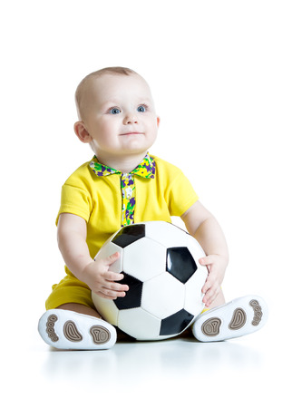 sport balls: adorable kid boy with foot ball isolated white background Stock Photo