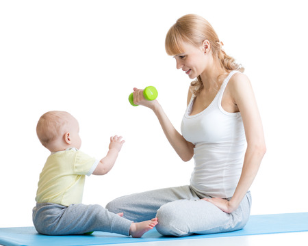 mama: Mother and little kid spending time in gymnastics isolated