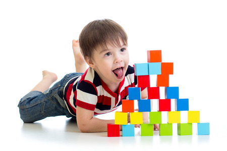 funny kid playing toy blocks isolated on white background photo