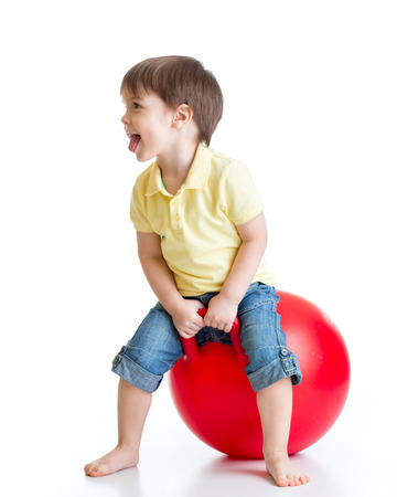big ball: Happy child jumping on bouncing ball. Isolated on white.