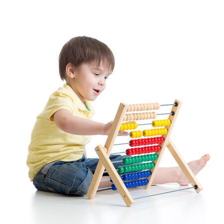Prodigy: Uśmiechnięty chłopiec dziecko gry z licznika zabawki Zdjęcie Seryjne