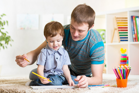 preschool: child boy painting in nursery at home