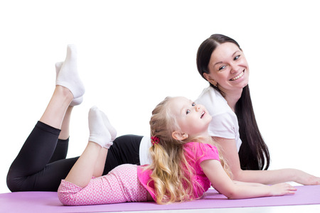 position d amour: femme heureuse et une fille de l'enfant exer�ant ensemble Banque d'images