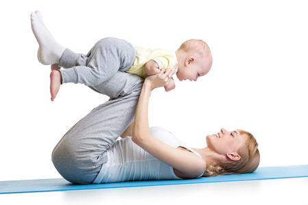 young woman have fun with baby son doing fitness exercises