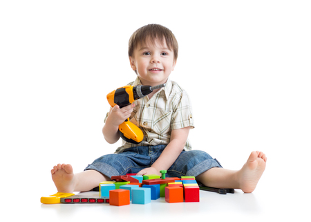 kid child boy playing with toys on floor isolated photo