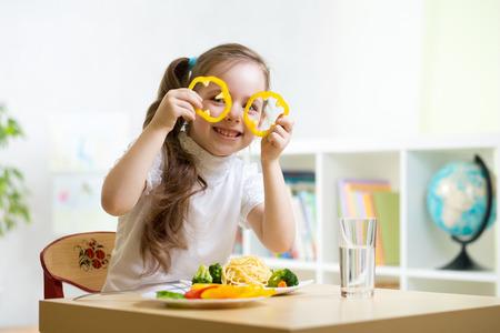 kid eating healthy food in kindergarten or at home