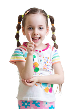 cute child girl counting and showing forefinger photo