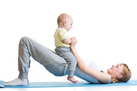 young mother doing fitness exercises together with baby
