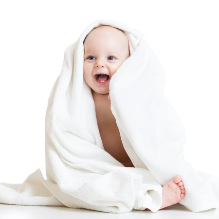 Adorable happy baby boy in bathing towel