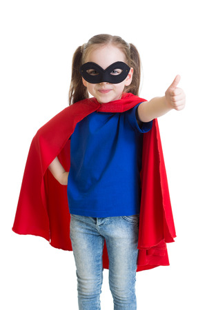 courageous: Child girl shows thumb up pretending to be a superhero