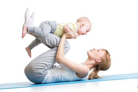strenuous: cute mother having fun with her son doing yoga exercises isolated