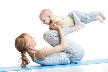 Yoga for woman and baby. Mother with child boy doing fitness exercises, isolated on white