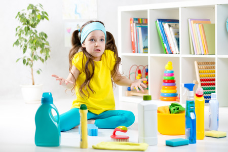 cleaning tools: Frustrated kid girl sitting on floor with cleaning tools