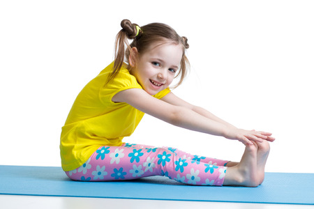 stretching exercise: Kid doing fitness exercises isolated on white