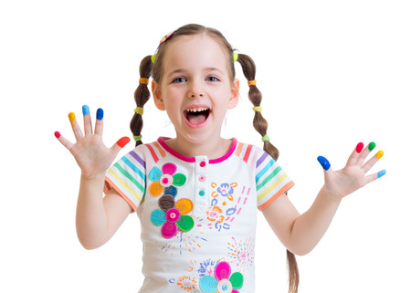 painted hands: happy child girl with color painted hands isolated