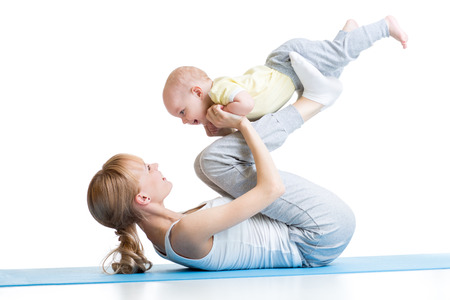 mother and baby make gymnastics, yoga exercises isolated on white