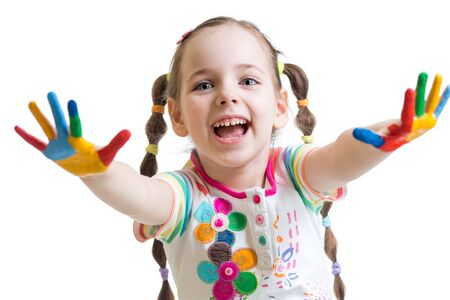 painting: smiling child girl with colorful hands in paints isolated on white