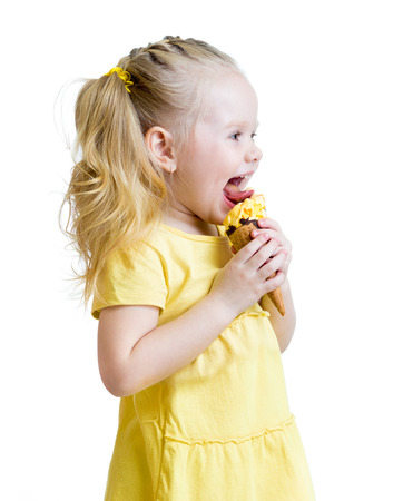 child girl eating ice-cream in studio isolated
