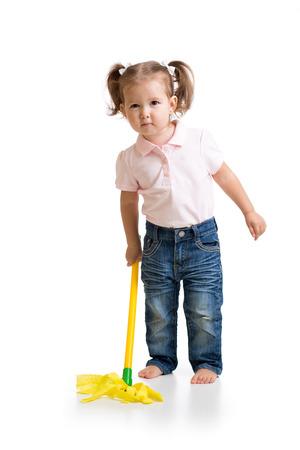 chore: Little child girl doing her chore of mopping the floor