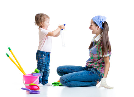 mother with kid girl cleaning room and having fun photo
