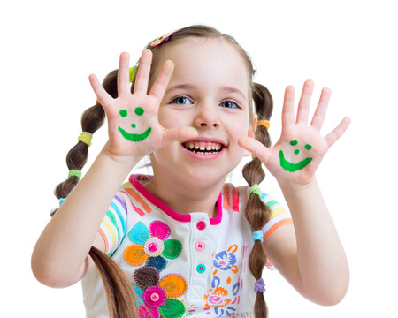 Little girl showing painted hands with funny face isolated photo