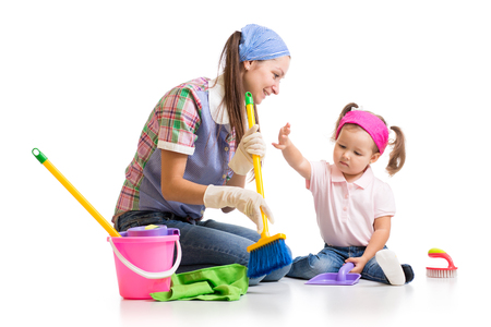 teaches: cute mother teaches daughter child cleaning room Stock Photo