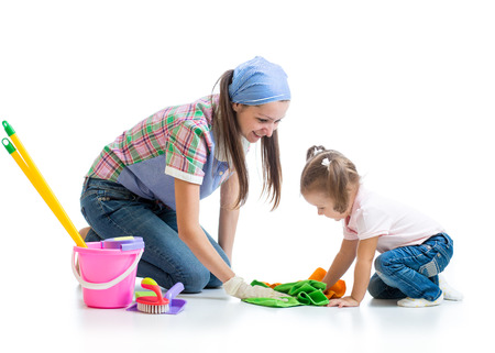 mother helping baby: cute young mother teaches daughter child cleaning room