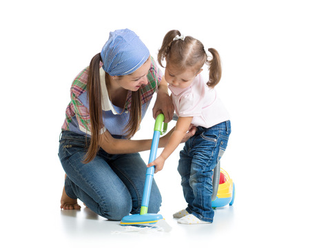 vaccuum: Little girl and woman with vacuum cleaner isolated Stock Photo