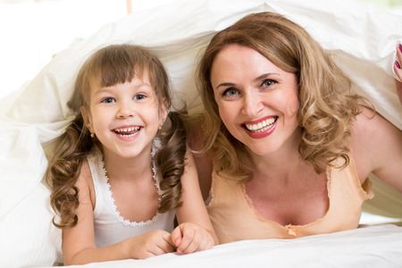 Child daughter and mother are happy together photo