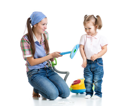 vaccuum: Child girl and mother with vacuum cleaner isolated