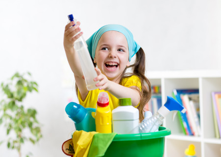 domestic chore: Cute kid little girl cleanses a floor in nursery