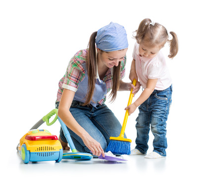 vaccuum: Child girl and mother sweep floor isolated Stock Photo