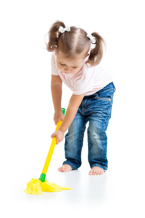 mopping: Child little girl doing playing and mopping the floor Stock Photo