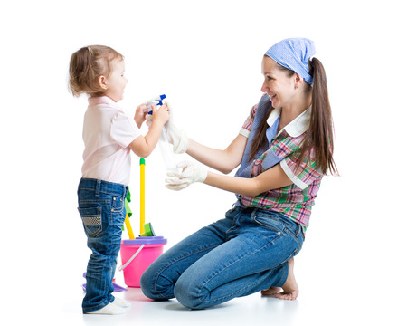 mother with child girl cleaning room and having fun photo