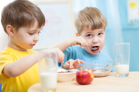 cute children eat healthy food enjoying breakfast