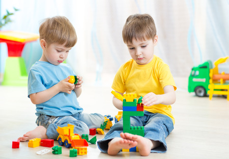 kindergarten toys: children play in nursery