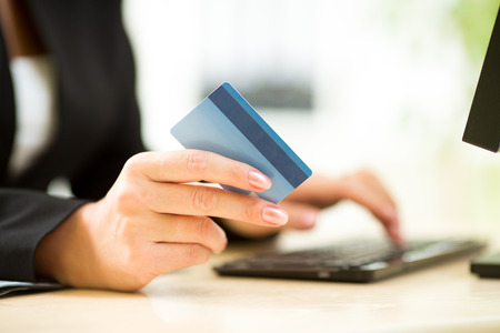 electronic store: business woman holding credit card on laptop for online payment concept Stock Photo