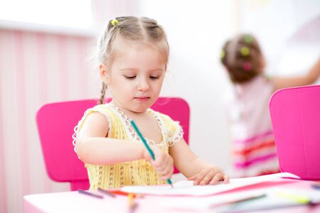 preschooler: children painting and drawing in nursery at home Stock Photo