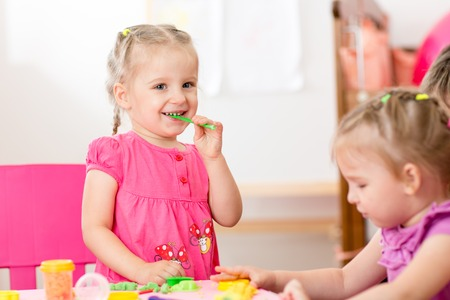 tinkering: children playing with play clay at home or  playschool