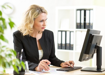 gorgeous businesswoman: Businesswoman working with laptop at the office