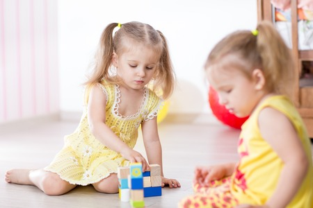 family activities: kids friends play together in kindergarten nursery