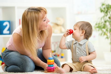 pastime: mother with her child son play together having fun pastime